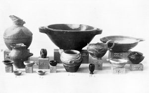 Stone and clay vases from Tombs IV and V. Scale about 1:4.