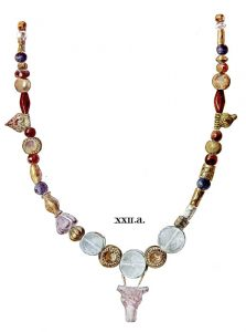 Necklace of gold, crystal, amethyst and cornelian beads from Tomb XXII. Slightly enlarged.